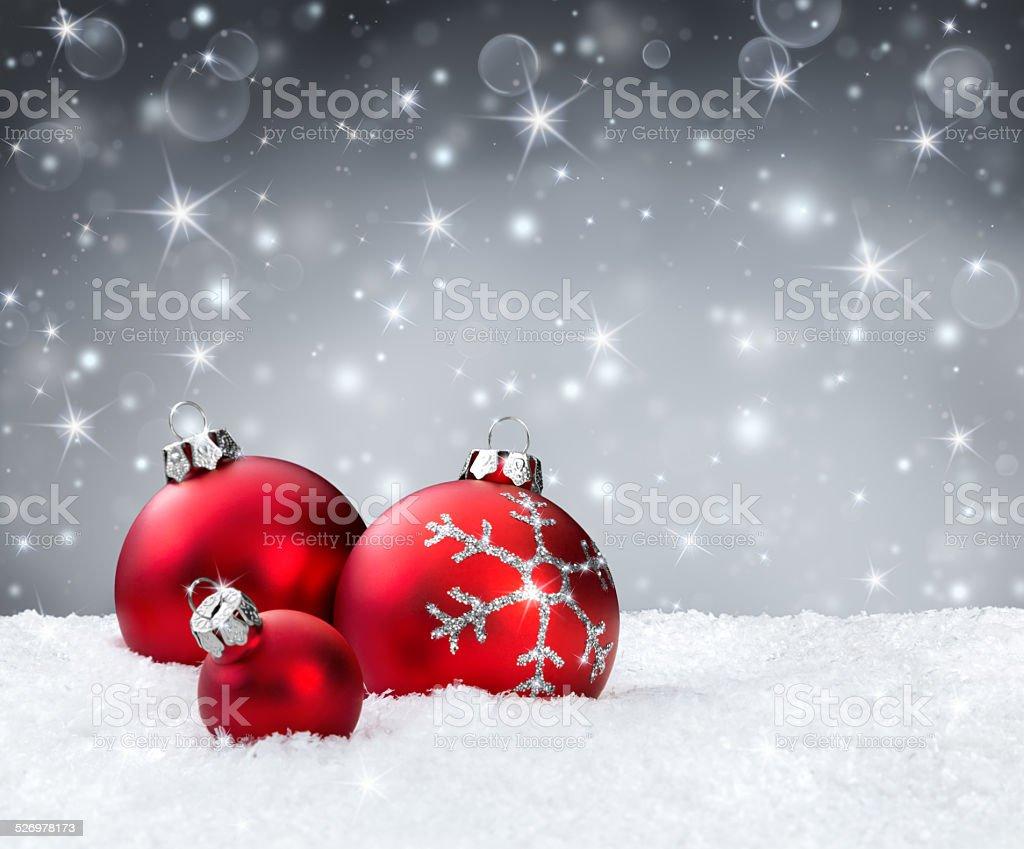 red christmas balls on snowflakes stock photo
