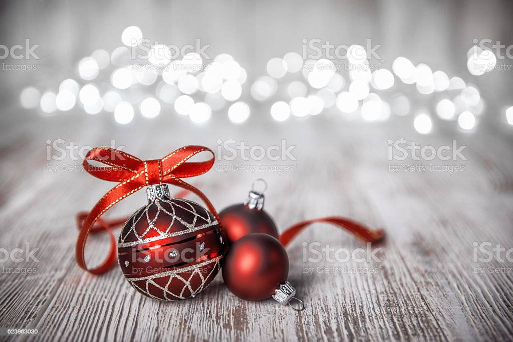 Red Christmas Balls Ribbon Bow decorated on Rustic Board stock photo