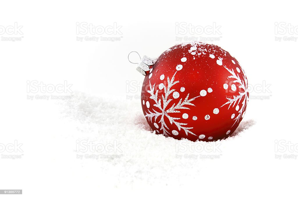 Red christmas bauble in snow royalty-free stock photo