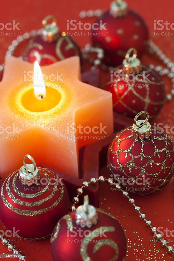 Red Christmas Baubles & Star Shape Candle stock photo