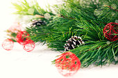 Red Christmas baubles with pine on white background