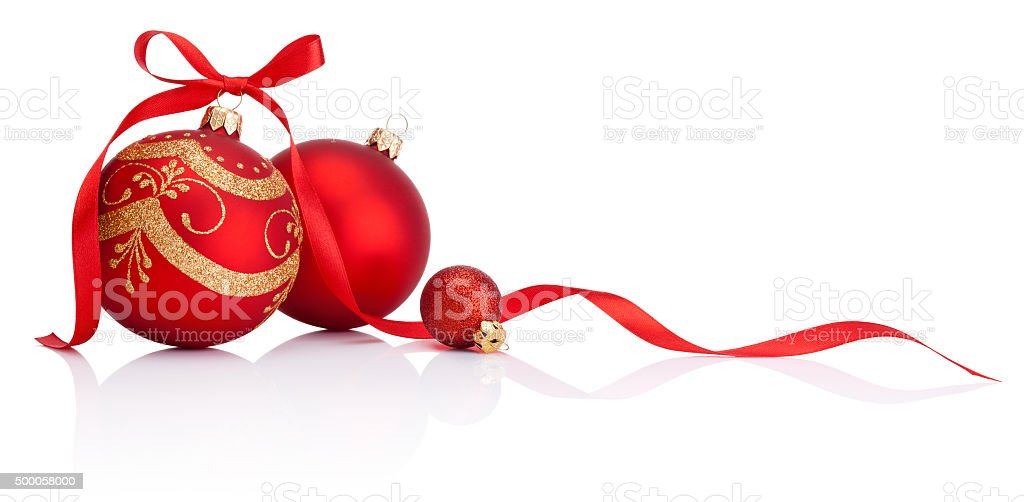 Red christmas baubles with ribbon bow isolated on white background stock photo