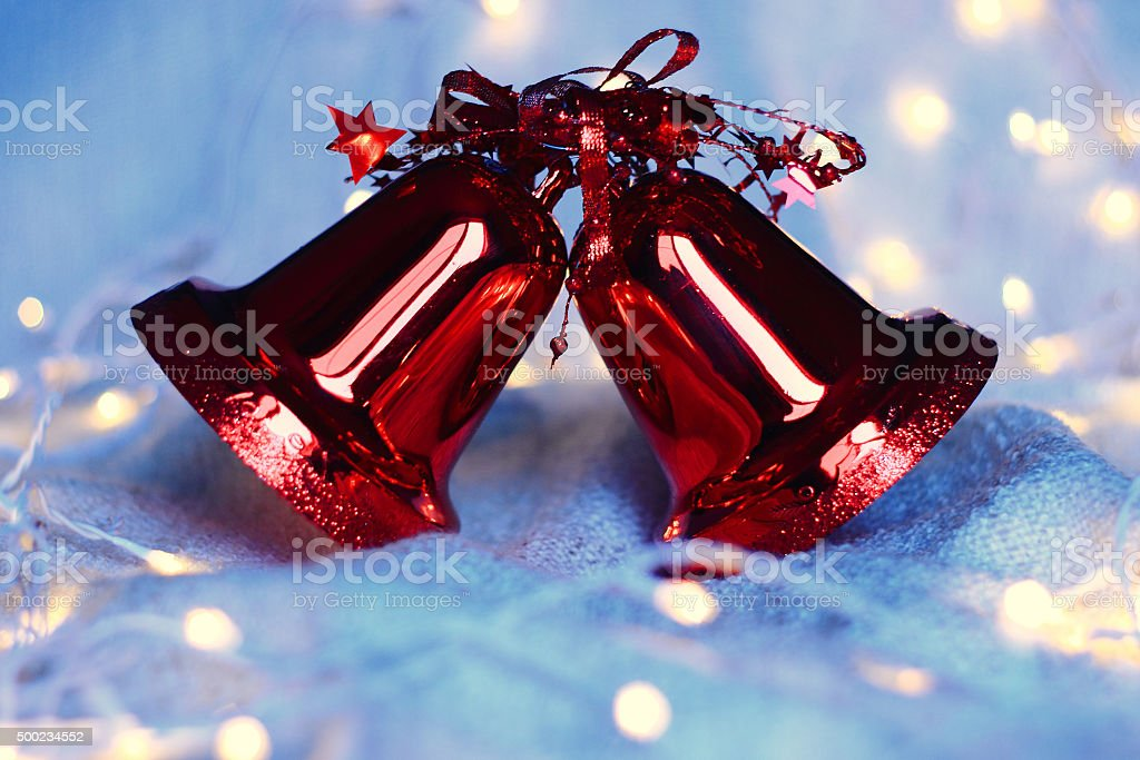 Red Christmas bells and garland lights stock photo