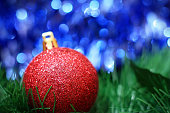 Red christmas decoration ball with blue bokeh