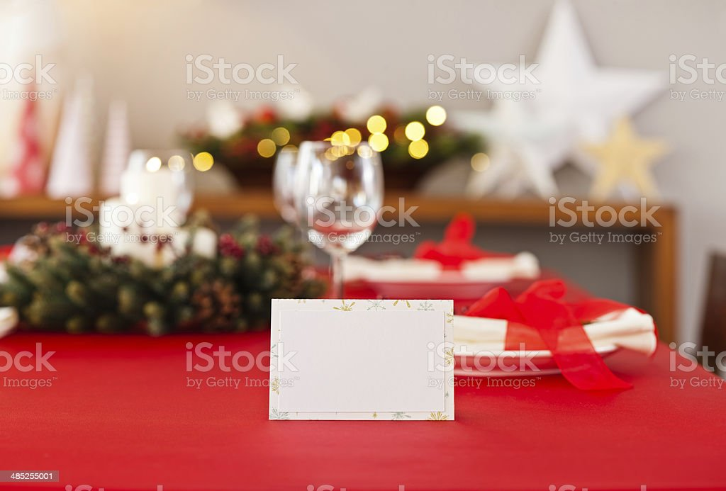 Red Christmas dinner table setup with name card stock photo