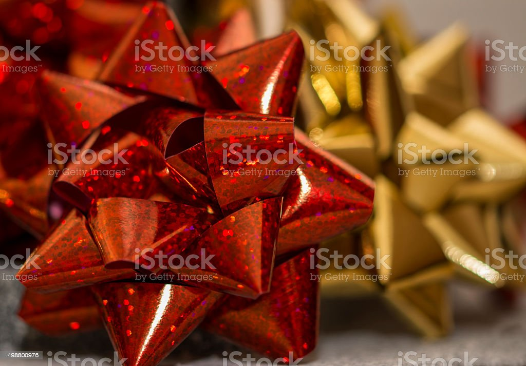 Red christmas gift wrapping bow stock photo