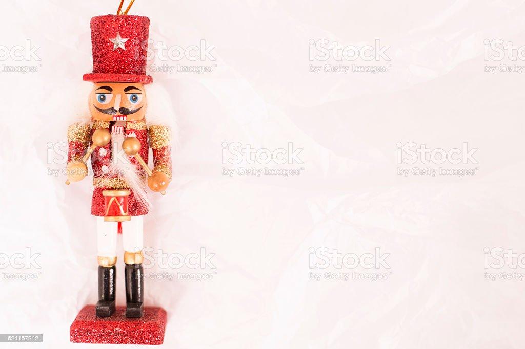 Red Christmas nutcracker ornament on white. stock photo