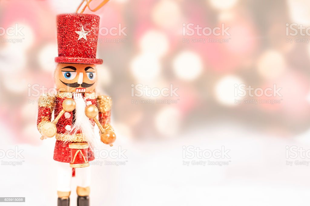 Red Christmas nutcracker ornament with colorful holiday lights. stock photo