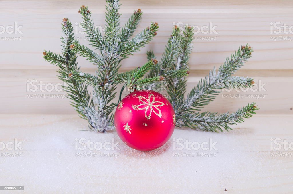 Red Christmas ornament and a fir tree covered with snow royalty-free stock photo