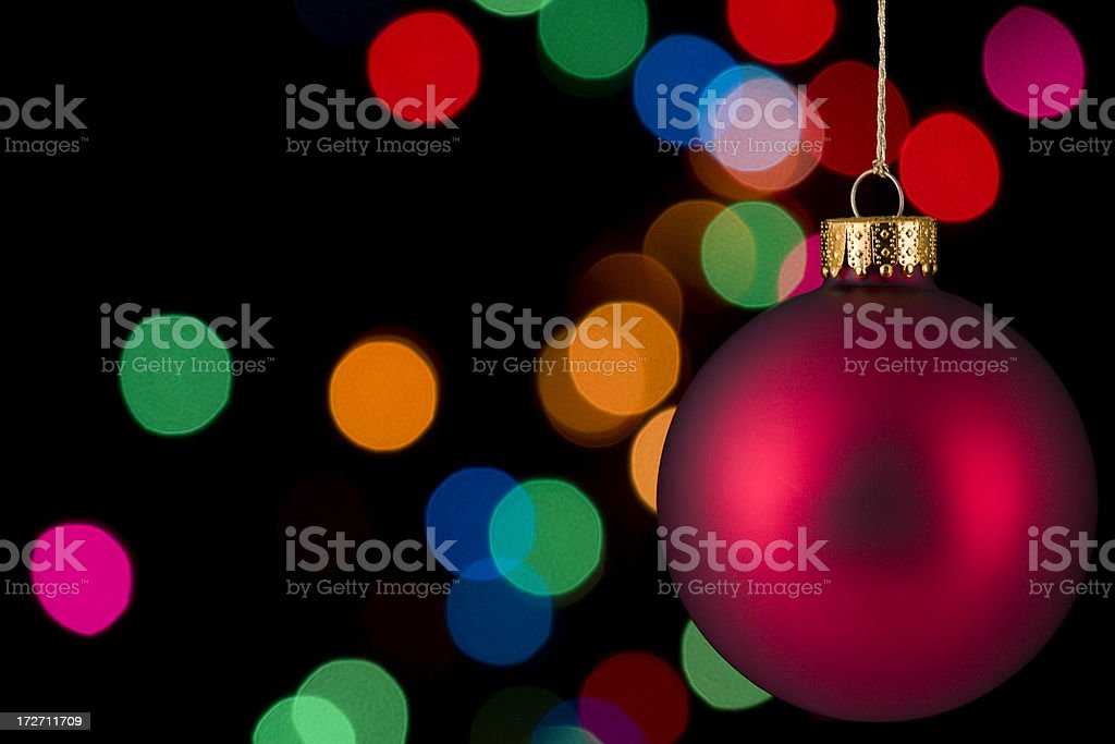 Red Christmas Ornament on black with lights stock photo
