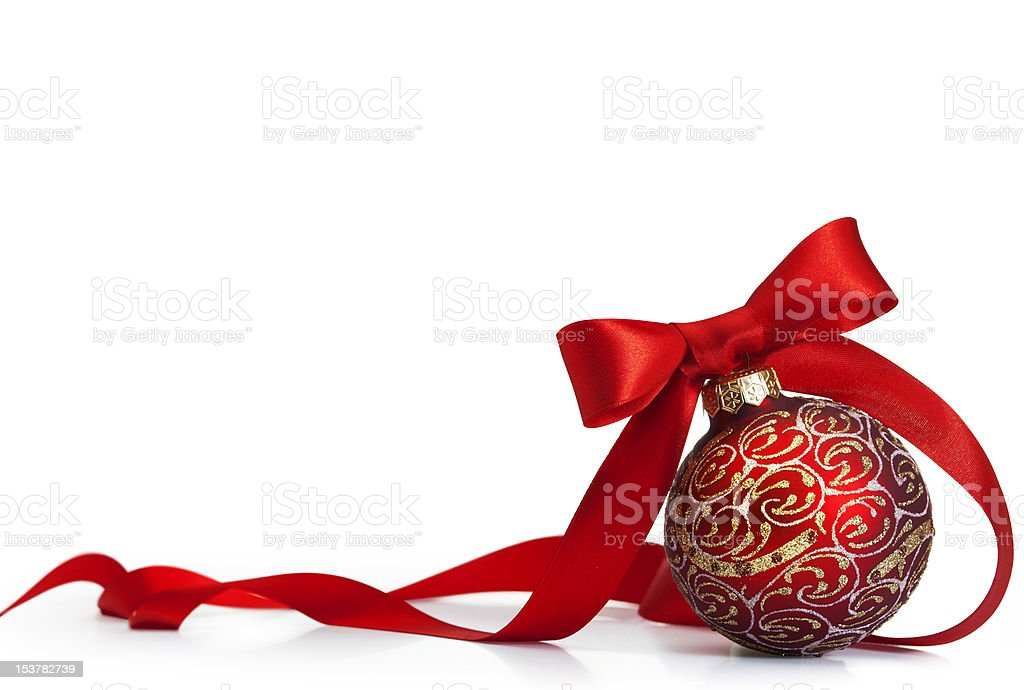 Red Christmas ornament with gold glitter pattern and red bow stock photo