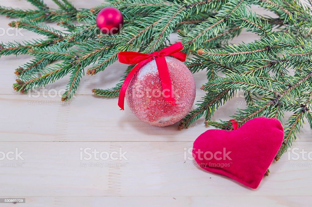 Red Christmas ornaments and a fir tree royalty-free stock photo