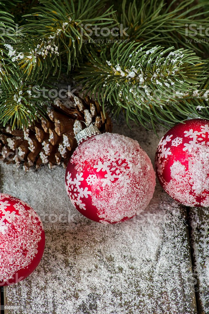 Red Christmas ornaments in the snow stock photo