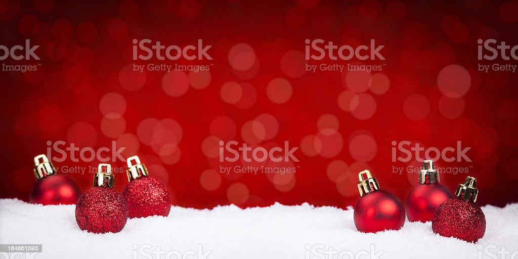 Red Christmas ornaments on abstract background royalty-free stock photo