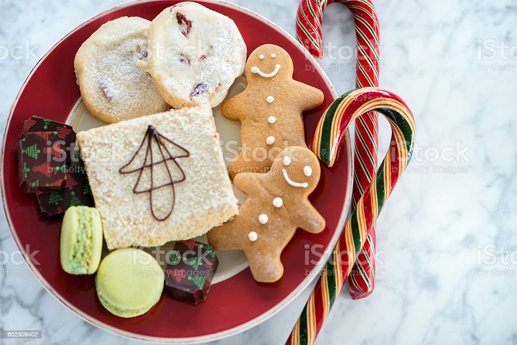Red Christmas Plate, Homemade Cookies, Baking, Candy on Marble Background stock photo