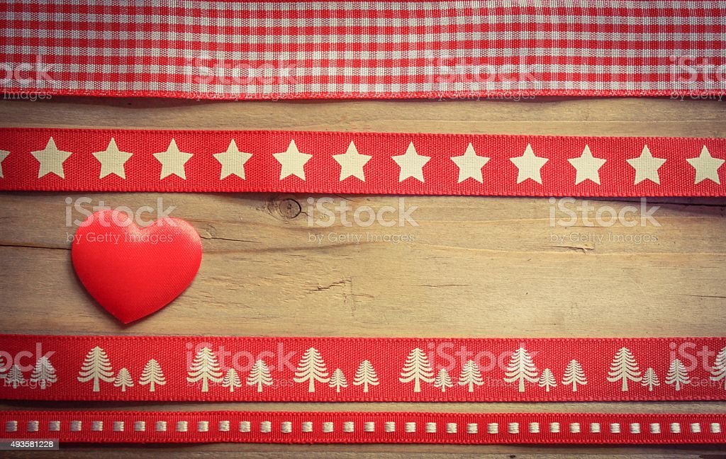 Red christmas ribbon and a heart stock photo