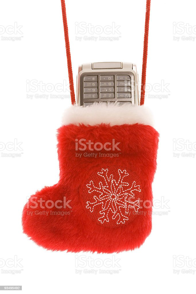 Red christmas sock with cellular phone royalty-free stock photo