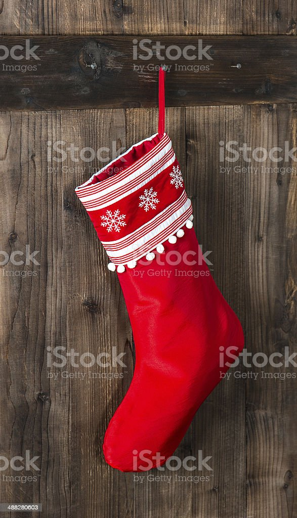 red christmas sock with snowflakes for Santa gifts stock photo