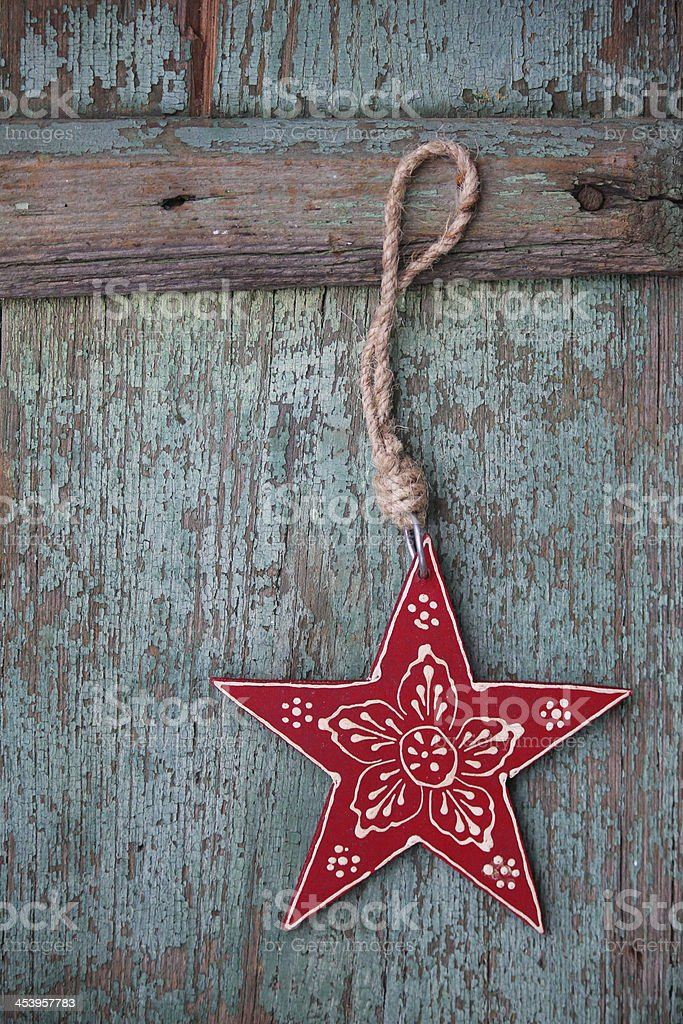 Red Christmas star ornament on old blue wood background stock photo