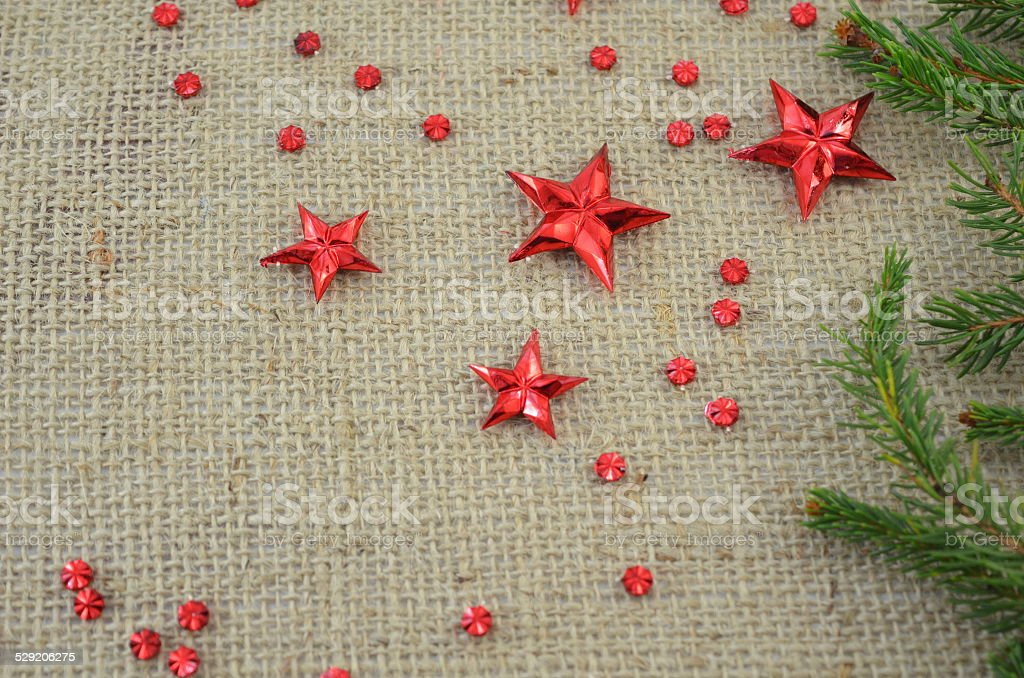 Red Christmas stars and a fir tree branch royalty-free stock photo