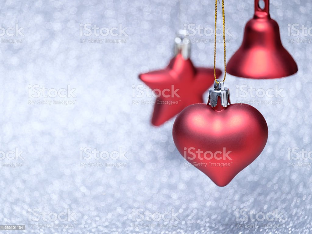 Red Christmas toys on glitter background stock photo