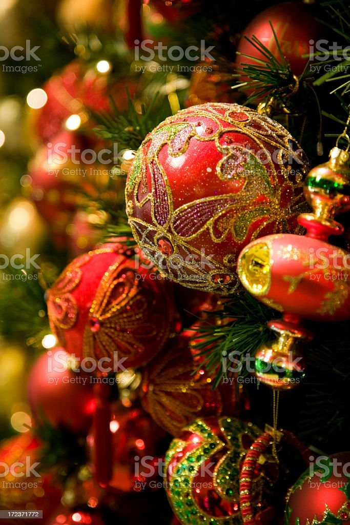 Red Christmas tree ornaments decorated with gold designs royalty-free stock photo