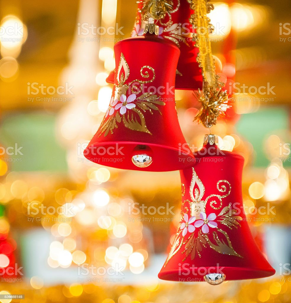 Red Christmas-bell hanging at tree - golden background stock photo