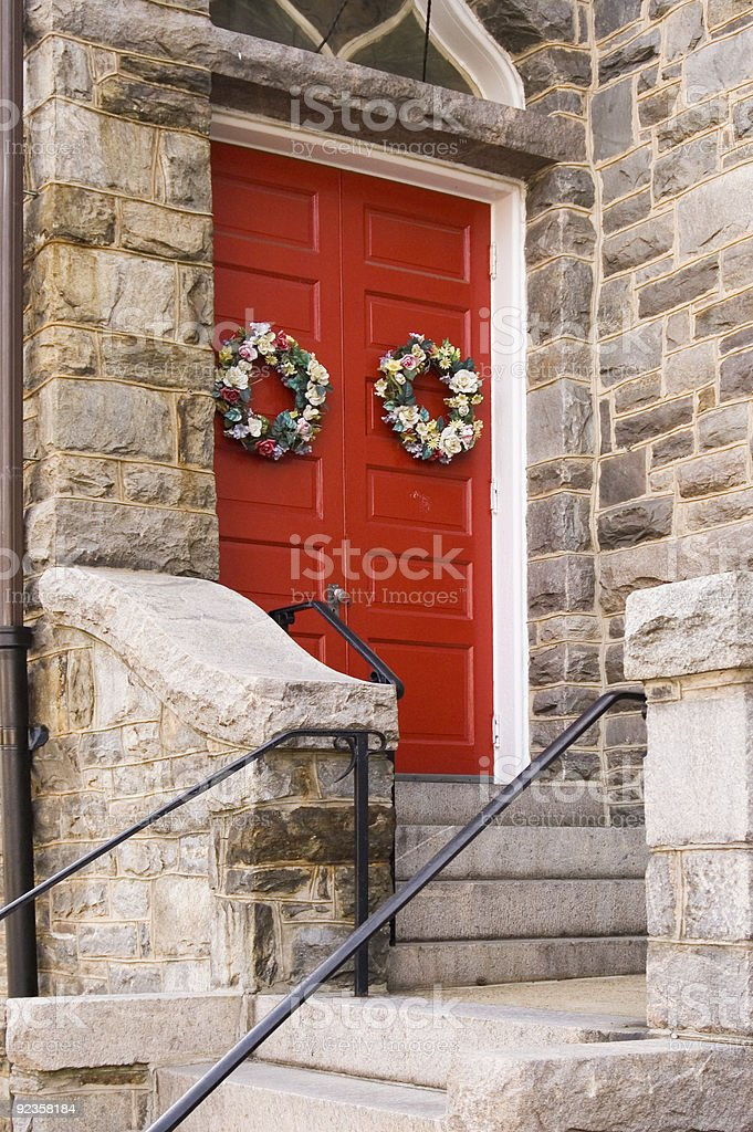 Red Church Door with Holiday Decoration royalty-free stock photo