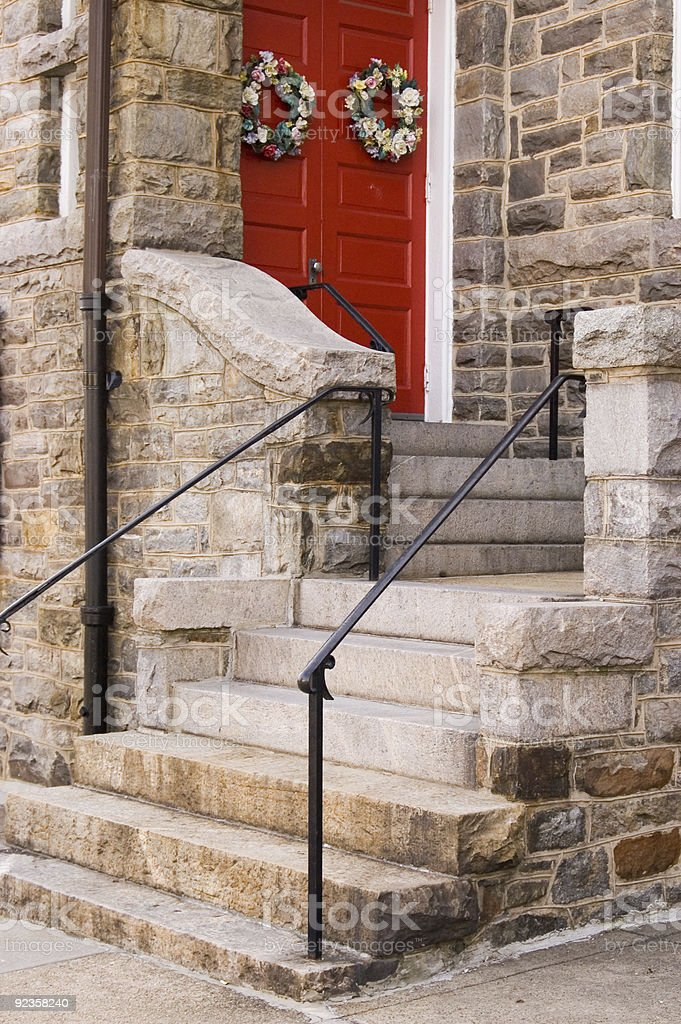 Red Church Door with Holiday Decoration stock photo
