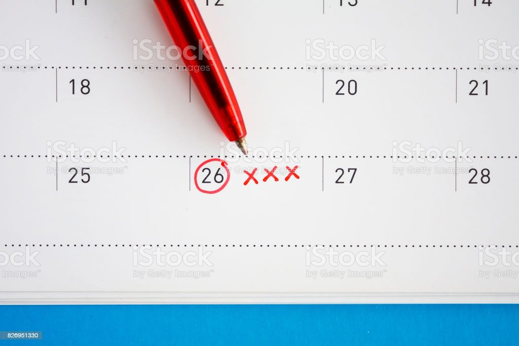 Red circle and xxx sign mark on the calendar stock photo