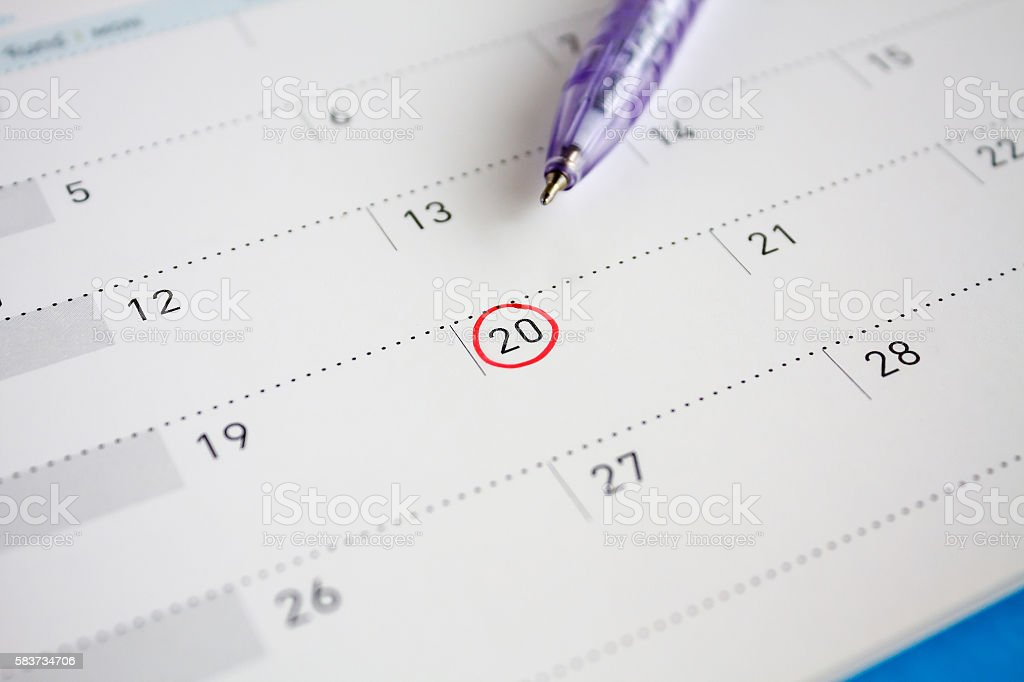 Red circle mark on the calendar at 20th stock photo