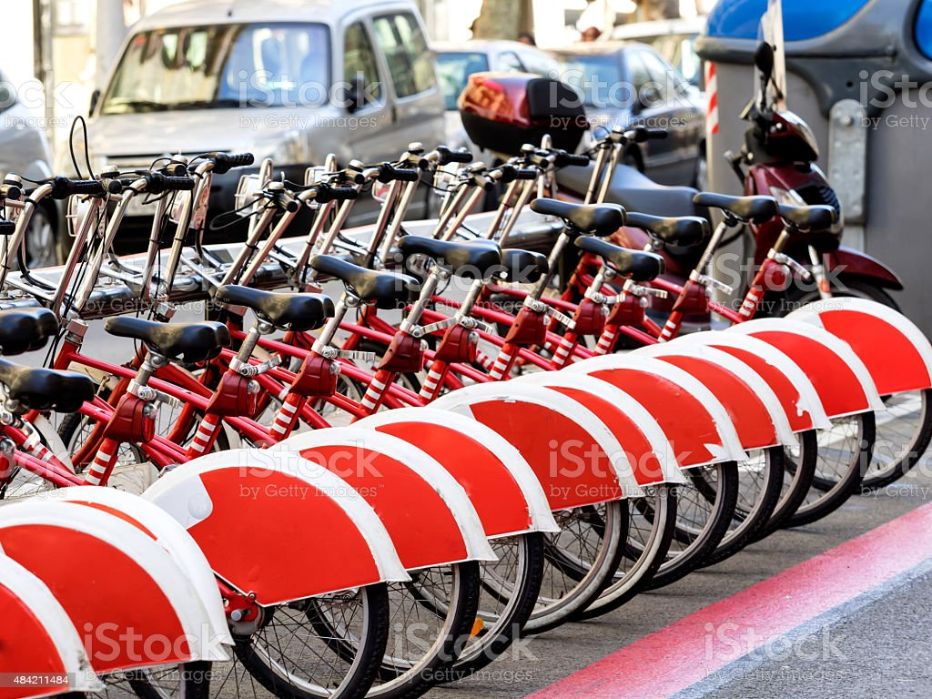 Red city bikes, bicycles in Barcelona stock photo