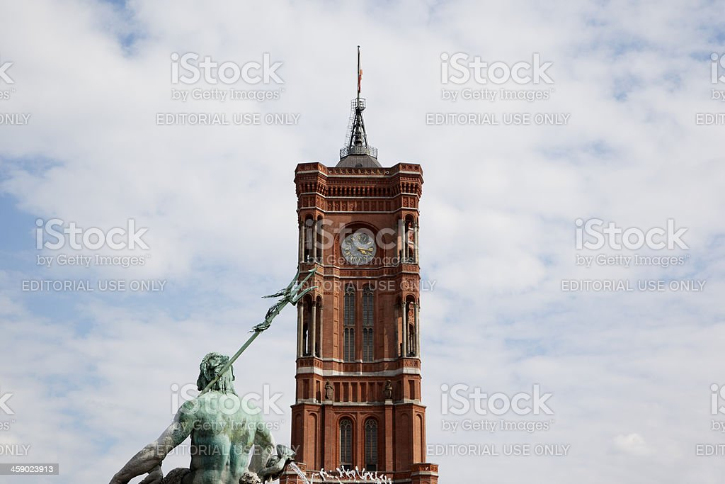 Red City Hall tower with the Neptune royalty-free stock photo