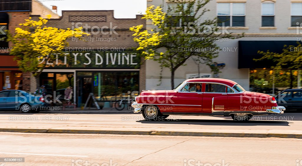 Red Classic Car Driving Downtown Missoula Montana Western USA stock photo
