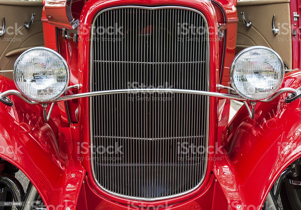 Red Classic Collectors Car Front End Grill And Headlights royalty-free stock photo