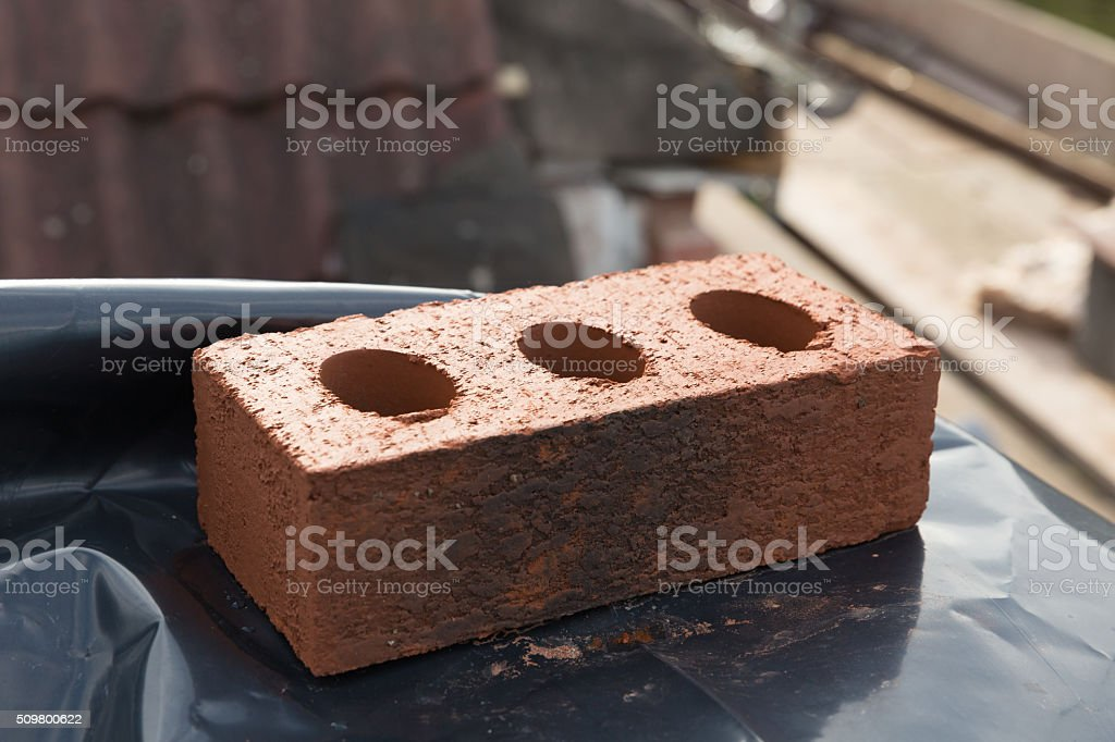 red clay English house brick on site stock photo
