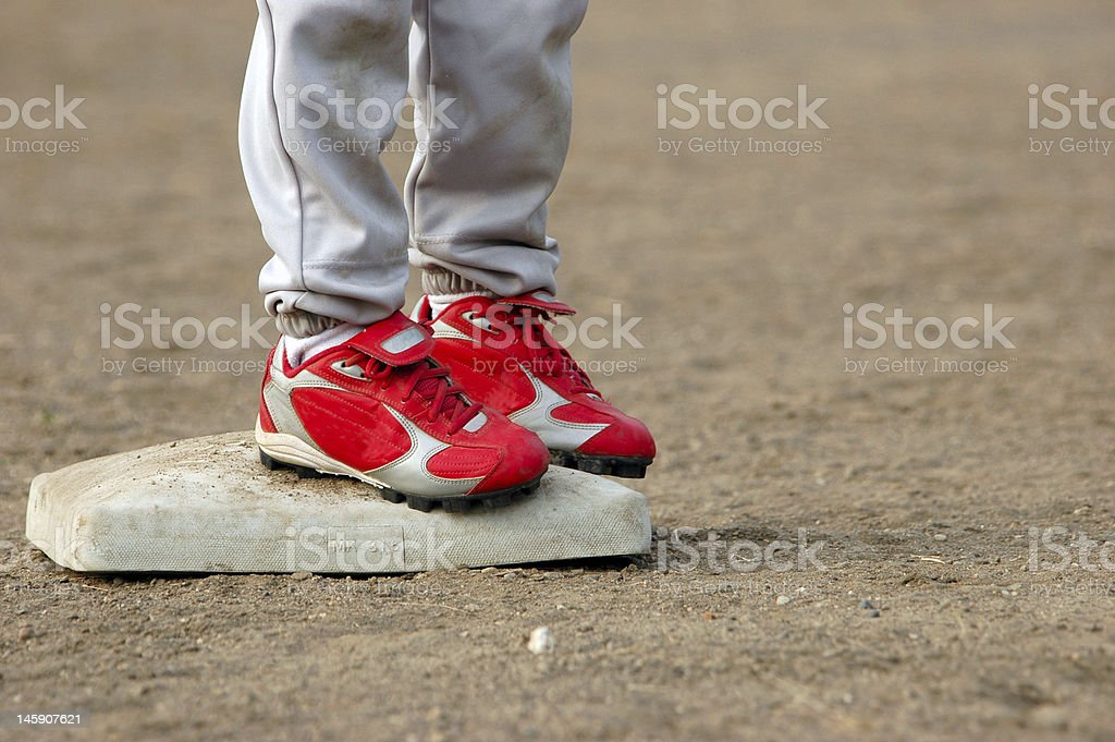 Red Cleats Safe on Base stock photo