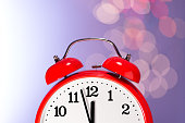 Red Clock and Bokeh Lights