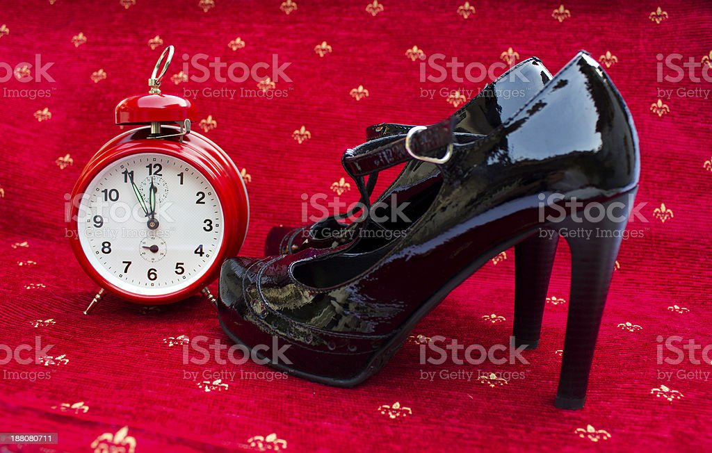 Red clock and high heels stock photo