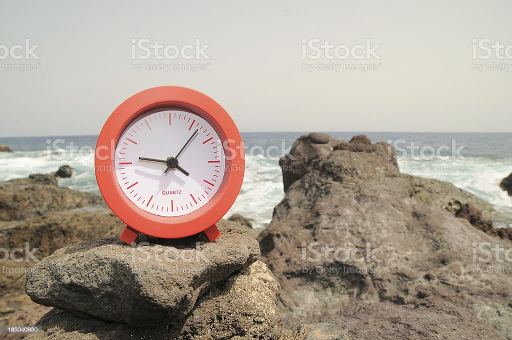 Red Clock Near the Ocean royalty-free stock photo