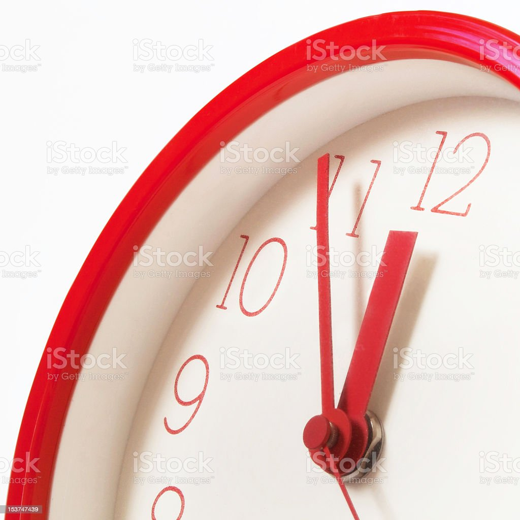 A red clock showing five minutes to midnight royalty-free stock photo