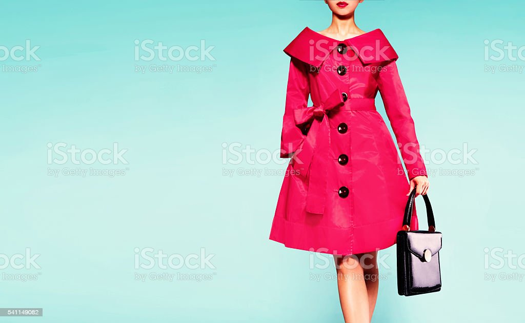 Red coat woman with black leather handbag. Beautiful vintage style. stock photo