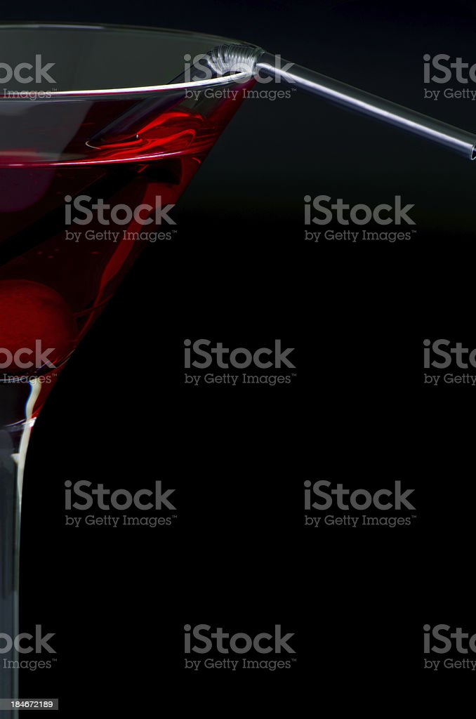 Red cocktail on black background with copy space stock photo