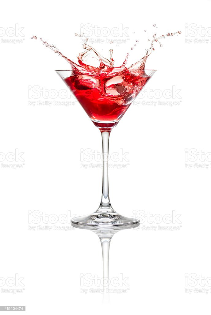 Red cocktail with ice cubes and splash stock photo