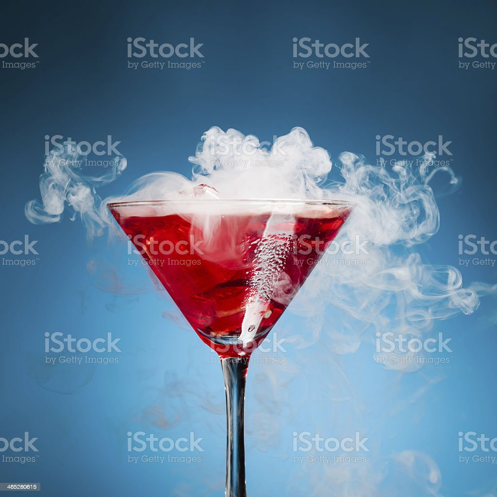 red cocktail with ice vapor stock photo