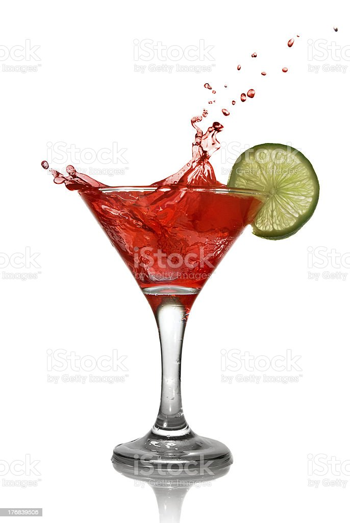 Red cocktail with lime slice on white background stock photo