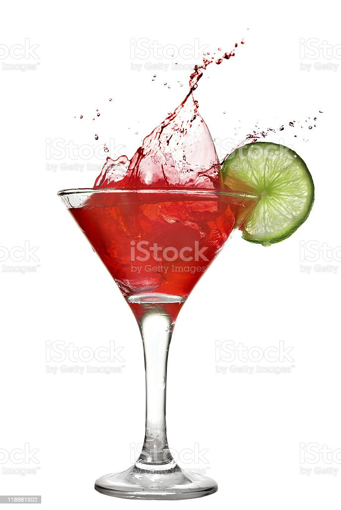 Red cocktail with splash and lime slice isolated on white royalty-free stock photo