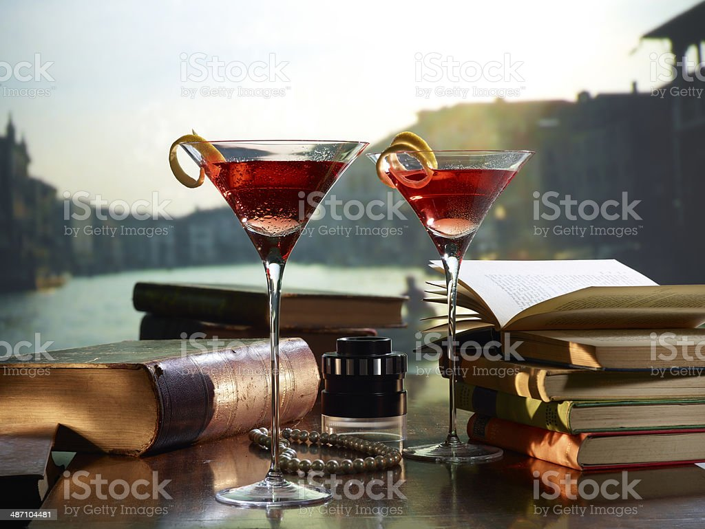 Red Cocktails with books in Venice stock photo