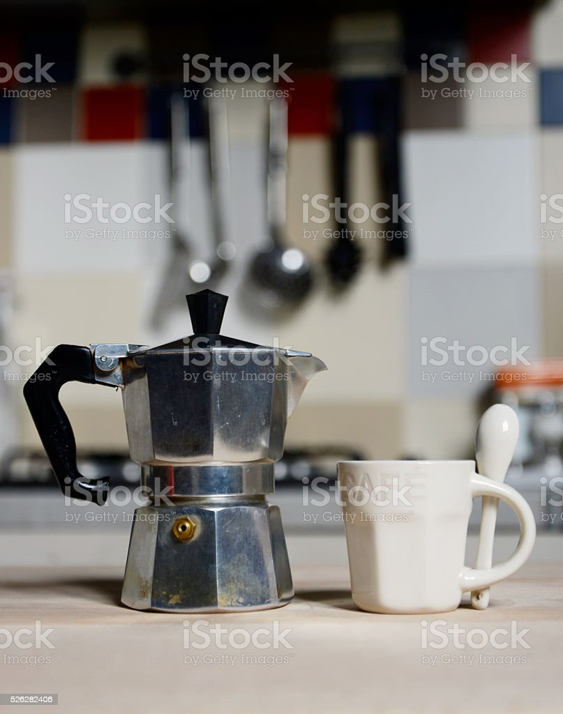 red coffee cup and  vintage coffeepot on kitchen stove stock photo
