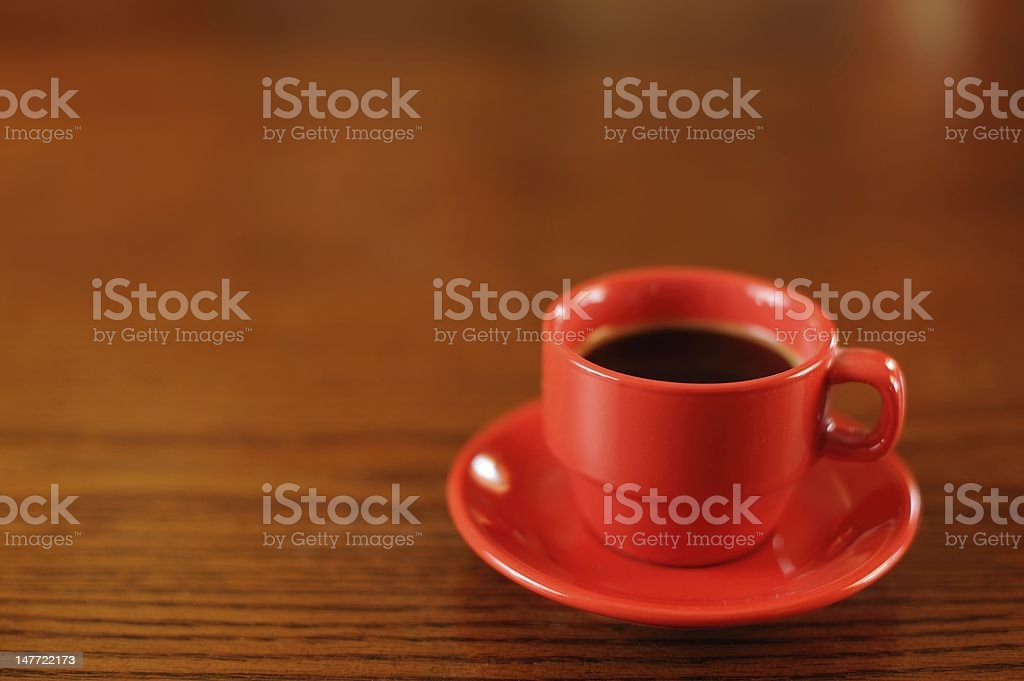 Red Coffee Cup on Wooden Table royalty-free stock photo